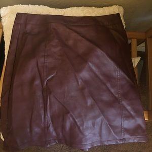 Wine color mini leather skirt